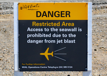 A sign at the end of the airport runway at Wellington, New Zealand, warning of the dangers of jet blast and standing too close.