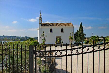 Small chapel on a peninsula on the Greek island of Corfu