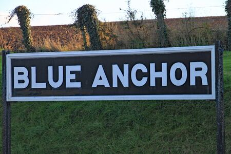 The Blue Anchor sign on the platform on the heritage railway. The next and final stop is Minehead. 免版税图像