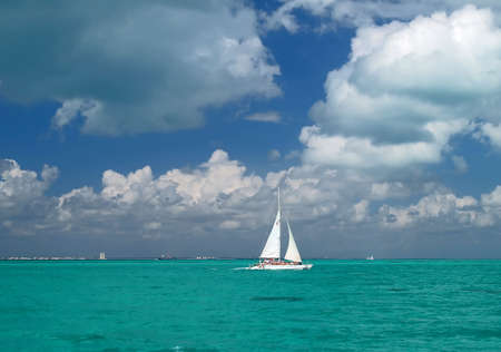emptiness: a sailing boat nare a beach resort in Cancun Mexico Stock Photo