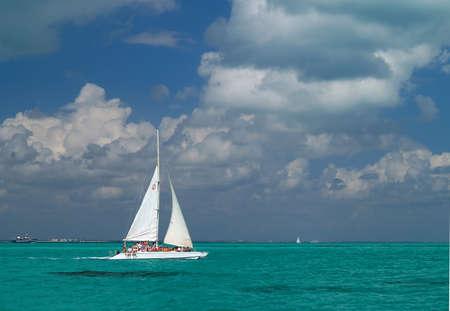 a sailing boat nare a beach resort in Cancun Mexico photo