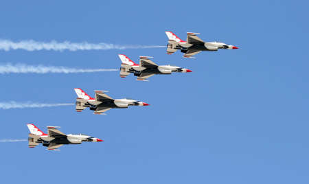 A fighter formation at a air show photo