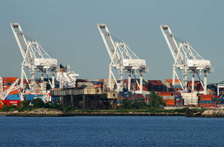 The cranes at a port in New York Harbor Stock Photo