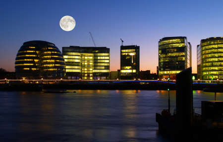Office buildings at night in London UK photo