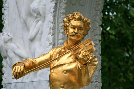 The Statue of Johann Strauss in stadtpark in Vienna, Austria  photo