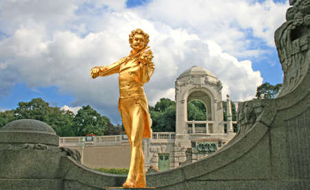 The Statue of Johann Strauss in stadtpark in Vienna, Austria photo