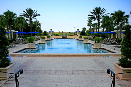 the landscape and swimming pool in a tropical resort