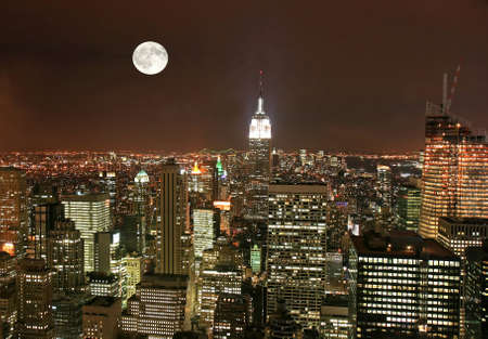 old moon: New York City midtown skyline at dark