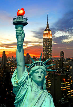 The Statue of Liberty and New York City skyline at dark Stock Photo - 2268890