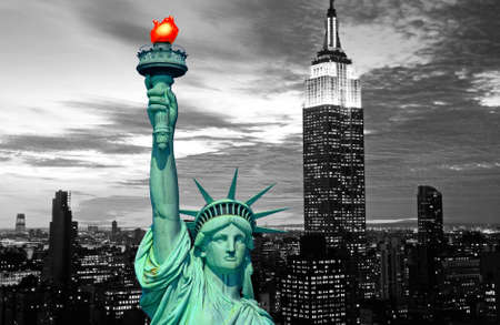 Statue of Liberty and New York City skyline at dark Stock Photo