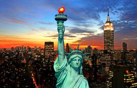 work popular: The Statue of Liberty and New York City skyline at dark