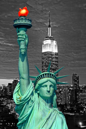Statue of Liberty and New York City skyline at dark photo
