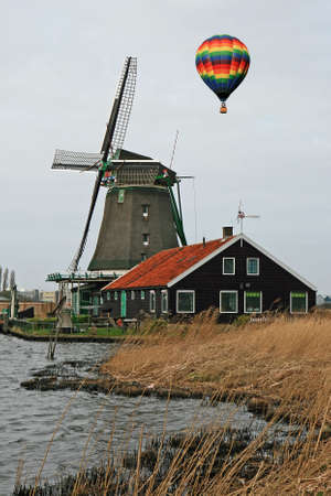 Hot air balloon and Windmill in Holland photo