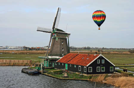 windy energy: Hot air balloon and Windmill in Holland
