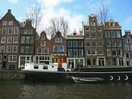 car retailer: The scenery along the street and canal of Amsterdam