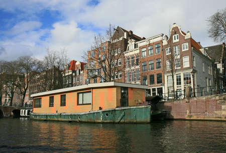 The scenery along the street and canal of Amsterdam  photo