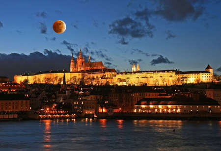 The Prague Castle in Prague and moon eclipse
