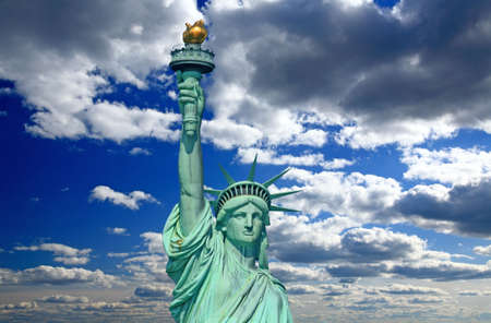 The statue of Liberty under sunny sky photo