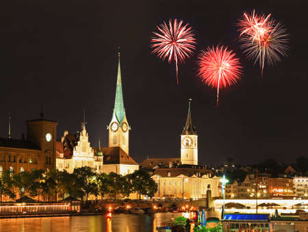 grossmunster cathedral: The Zurich City Skyline at night with firework illustration Stock Photo