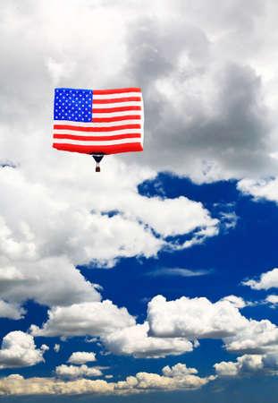 An American flag hot-air balloon under a sunny sky