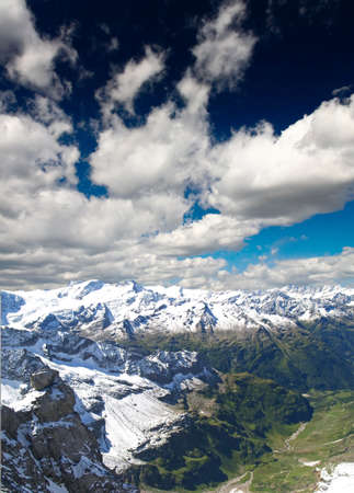 snow covered mountains at summer time in Swizerland photo
