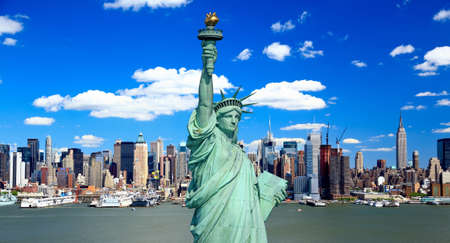 liberty: The Statue of Liberty and Manhattan Midtown Skyline USA Stock Photo