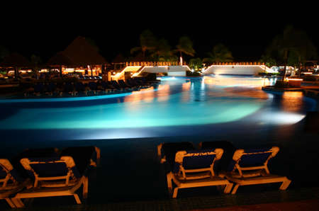 a luxury all inclusive beach resort at night in Cancun Mexico