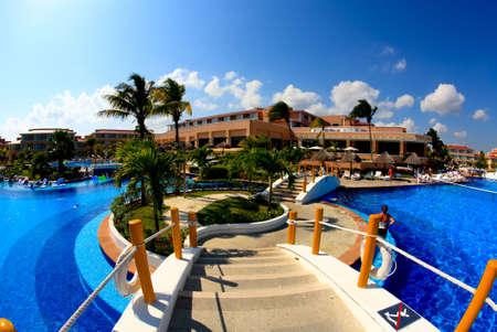 inclusive: a fish-eye view of a luxury all inclusive beach resort in Cancun Mexico