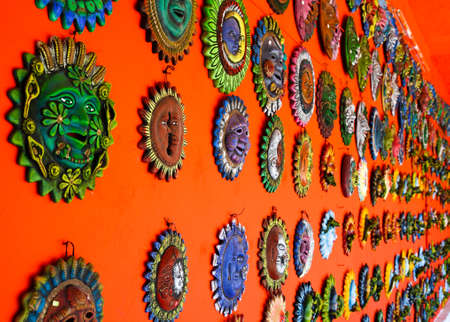 Mexican decoration plates in a Mayan souvenir shop Banco de Imagens