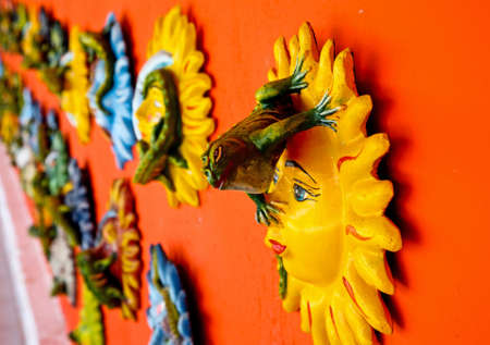 contrasted: Mexican decoration plates in a Mayan souvenir shop Stock Photo