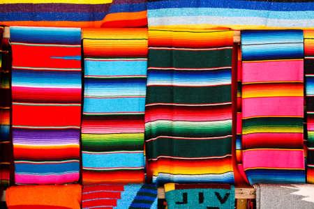 Mayan Blankets hanging at a Mayan souvenir shop Stock Photo