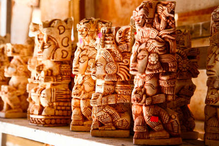 Mexican statues in a Mayan souvenir shop