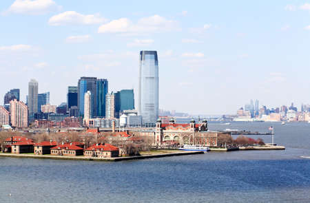 ellis: The Ellis Island and the office buildings in New Jersey Stock Photo