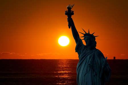 The Statue of Liberty at a beautiful sunset   photo