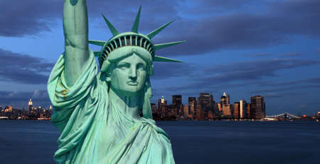 The Statue of Liberty and New York City skylines as the background photo
