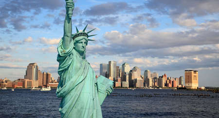 The Statue of Liberty and Lower Manhattan Skyline New York City photo