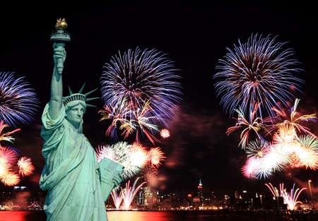liberty torch: The Statue of Liberty and 4th of July fireworks in NYC Stock Photo