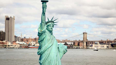 The Statue of Liberty and Brooklyn bridge in New York City Stock Photo - 5632526