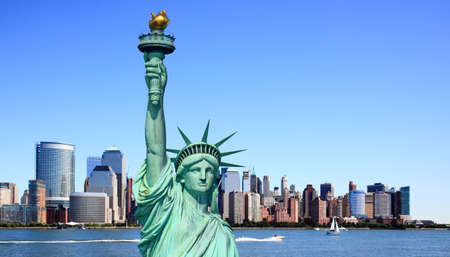 The Statue of Liberty and Lower Manhattan Skylines New York City    photo