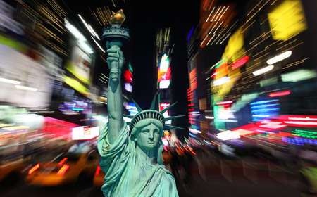 The statue of Liberty and times square in the New York City  photo