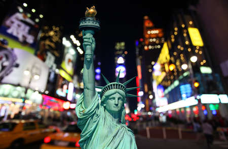 square: The statue of Liberty and times square in the New York City