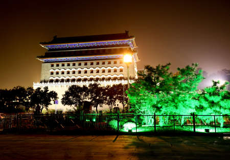 reconstruct: the famous Qianmen Gate in Beijing located just south of Tiananman Square at night Stock Photo