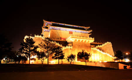 architectural architectonic: the famous Qianmen Gate in Beijing located just south of Tiananman Square at night Stock Photo