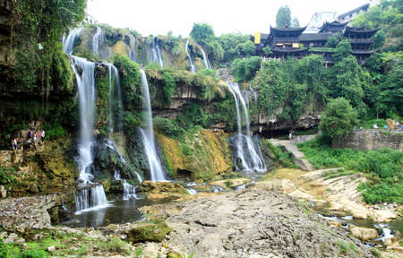 best known: Water falls in a scenery Chinese minority village best known in the movie Furongzhen