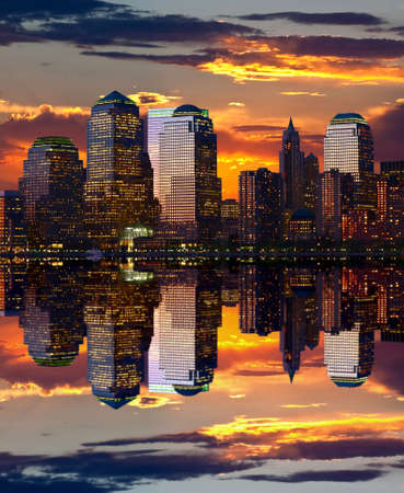 Manhattan skylines in a perfect symmetric reflection  Stock Photo