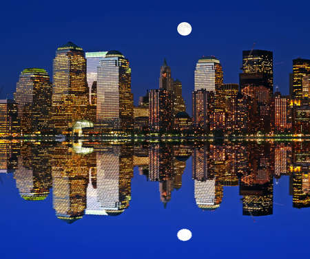 Manhattan skylines at night in a perfect symmetric reflection  photo