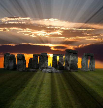The famous Stonehenge in England on a sunrise background  photo