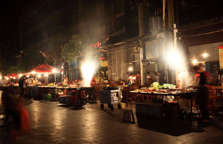 PHOENIX TOWN CHINA - AUGEST 6, 2009 - The nightly BBQ food market attracted many tourists in the one the four most attractive small towns in China Stock Photo - 6890878