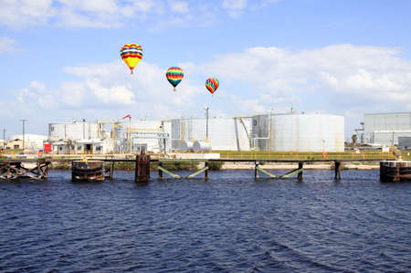 tampa bay: oil tanks in the port of Tampa Florida on a cloudy day      Stock Photo