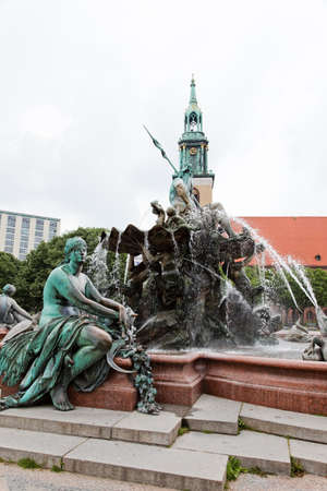 king neptune: Statue of Poseidon (Neptune God) in front of  fernsehturm in Berlin
